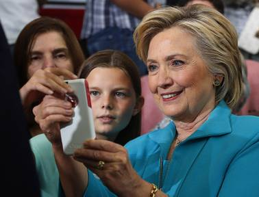 Democratic presidential candidate Hillary Clinton takes cellphone photos with people in the audience at a campaign event at Truckee Meadows Community College in Reno, Thursday, Aug. 25, 2016.