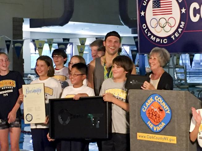 Las Vegas Olympian Cody Miller stands with the gold and bronze medals he won in the 2016 Summer Olympics in Rio de Janeiro during a recognition ceremony at the Desert Breeze Aquatic Facility, Monday, Aug. 29, 2016.