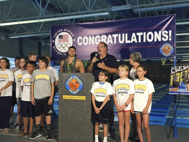 Las Vegas Olympian Cody Miller stands with Sandpipers coach Ron Aitken and current members of the Sandpipers of Nevada swim team on Monday, Aug. 29, 2016 at the Desert Breeze Aquatic Facility. Miller won gold and bronze medals during the 2016 Summer Olympics in Rio de Janeiro.