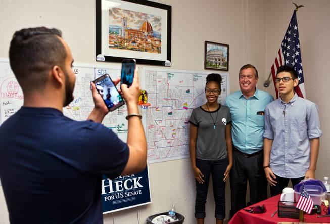 Republican Rep. Cresent Hardy joins new political volunteers in a photo during a stop over at a local campaign office on Saturday, August 27, 2016.