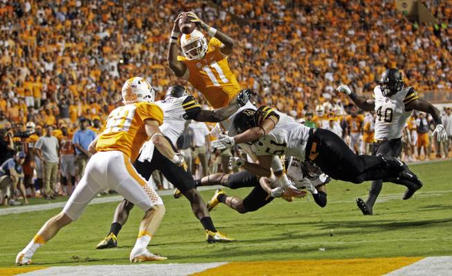 No. 11 Tennessee withstanding injuries, early deficits