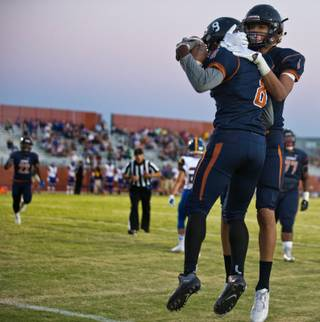 Legacy's Marquell Evans (8) celebrates with teammate Jamaal Britt (1) after a quick touchdown run over Moapa Valley during their high school football game on Friday, Sept. 9, 2016.