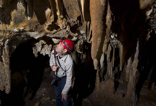 UNLV Geoscience professor Matthew Lachniet looks over formations in the Lehman Caves in the Great Basin National Park Thursday, Sept. 15, 2016.