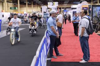 Attendees talk while others take advantage of a demo track to try out different rides during the annual Interbike International Bicycle Exposition, the largest industry show in North America, Wednesday, Sept. 21, 2016 at the Mandalay Bay Convention Center in Las Vegas.