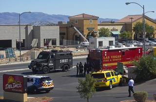 A SWAT vehicle leaves the scene after a shooting at the Starbucks on South Rainbow Boulevard near Warm Springs Road Sunday, Sept. 25, 2016. One man was killed after the shooting in the Starbucks, police said.