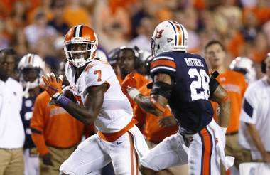 Clemson wide receiver Mike Williams carries the ball aast Auburn defensive back Tray Matthews pursues during the first half of an NCAA college football game, Saturday, Sept. 3, 2016, in Auburn, Ala.