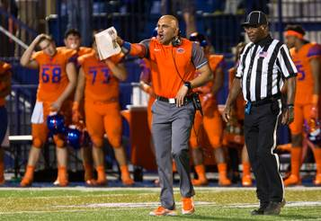 Bishop Gorman head coach Kenny Sanchez continues to argue a call as overtime begins with St. Thomas Aquinas during their game to help in controlling a possible three-time national championship on Friday, Sept. 30, 2016.