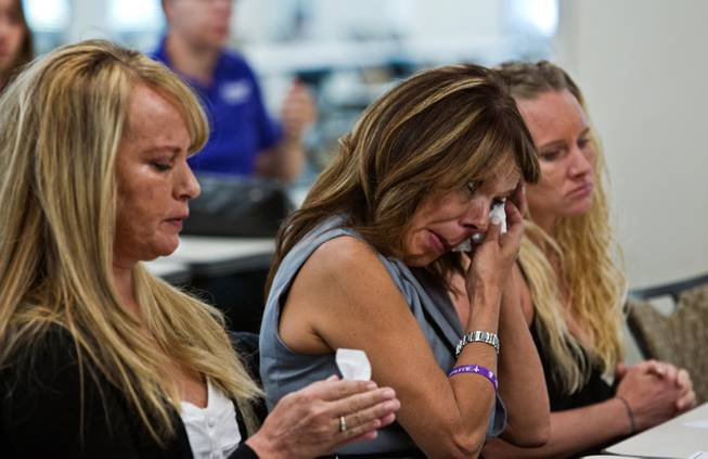 Participants shed some tears as victims who lost their lives due to domestic violence are remembered at a ceremony hosted by the Las Vegas Metropolitan Police Department and the Community Coalition for Victims' Rights on Thursday, Oct. 6, 2016.
