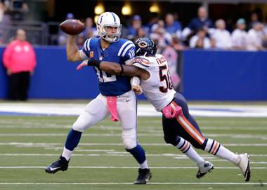 Indianapolis Colts quarterback Andrew Luck, left, is hit by Chicago Bears inside linebacker Jerrell Freeman on Sunday, Oct. 9, 2016, during the second half of an NFL game in Indianapolis.