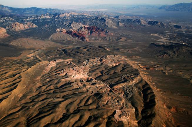 A gypsum mine owned by developer Jim Rhodes, who wants to develop housing on the site, is seen in the foreground while the Red Rock Canyon National Conservation Area is seen in the distance Saturday, Oct. 26, 2013.