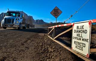 Another truck departs the Blue Diamond Hill Gypsum Mine which Developer Jim Rhodes is renewing his decade-long bid to develop as a master planned community with 5,000+ units on Tuesday, Oct. 11, 2016.