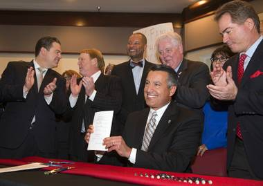 Gov. Brian Sandoval signed into law today $750 million of state funding toward building a $1.9 billion, 65,000-seat domed football stadium in Las Vegas. The bill raises hotel room taxes 0.88 percent to finance the public's part of the project. Sheldon Adelson of Las Vegas Sands Corp. has pledged ...