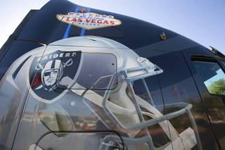 A truck decorated with a Raiders helmet and