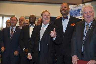 Raiders owner Mark Davis, center, gives a thumbs up during a bill signing ceremony at UNLV Monday, Oct. 17, 2016. Also pictured from left, Rossi Ralenkotter, president and CEO of the Las Vegas Convention and Visitors Authority, State Sen. Kelvin Atkinson, State Sen. Aaron Ford and Speaker of the Assembly John Hambrick.