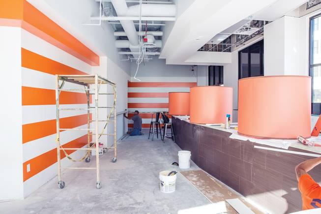 Workers prepare DW Bistro to open at the mixed-use development.