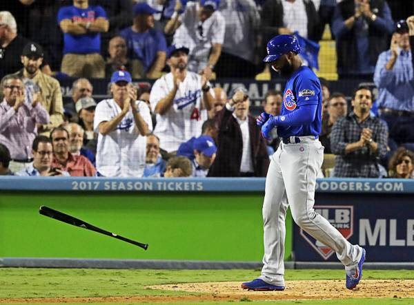 3a7e9c50460351 Chicago Cubs  Jason Heyward tosses his bat after striking out during the  seventh inning of Game 3 of the National League baseball championship  series ...