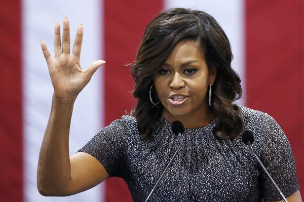 a1c9d82eb34bd First lady Michelle Obama waves to the crowd after speaking during a  campaign rally for Democratic presidential candidate Hillary Clinton  Thursday, Oct. 20, ...