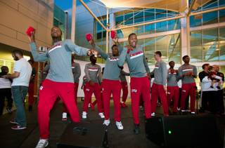 UNLV men's basketball players toss t-shirts to the crowd during The Runnin Rebel Rally, a student-centric event featuring both men and women's teams, entertainment, live music, cheer and food at the Student Union Courtyard on Wednesday, Oct. 26, 2016.