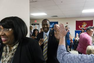 Ben Carson high-fives a support as he enters the building during a rally for Presidential Candidate Donald Trump at Trump-Pence Nevada Headquarters, Saturday, Nov. 5, 2016.