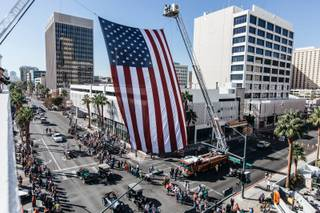 A crowd gathers to watch floats and participants in the Veterans Day parade in Downtown Las Vegas, Nev. on Nov. 11, 2016.
