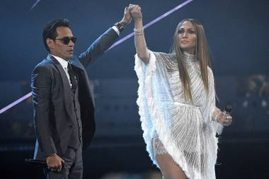 "Marc Anthony, left, and Jennifer Lopez perform ""Olvidame y Pega la Vuelta"" at the 17th annual Latin Grammy Awards at the T-Mobile Arena on Thursday, Nov. 17, 2016, in Las Vegas."