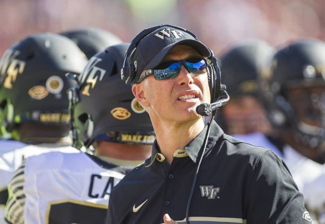 Wake Forest head coach Dave Clawson looks at the scoreboard in the first half of an NCAA college football game against Florida State in Tallahassee, Fla., Saturday, Oct. 15, 2016.
