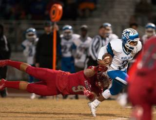 Liberty's Crishaun Lappin (9) makes a diving attempt at Basic QB Aaron McAllister (3) breaking off on a long run in the Sunrise regional high school football championship game on Friday, Nov. 18, 2016.