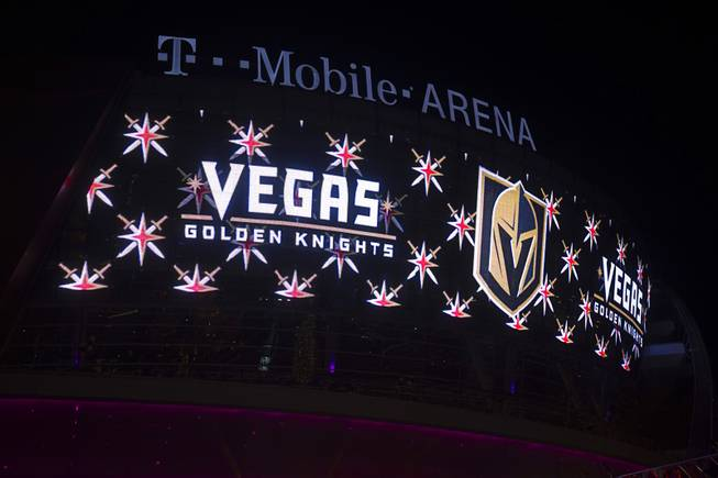 Owner Bill Foley, general manager George McPhee and NHL Commissioner Gary Bettman unveil the team's name and logo for the Las Vegas NHL franchise in the Toshiba Plaza at T-Mobile Arena Tuesday, Nov. 22, 2016. The team name is the Vegas Golden Knights.