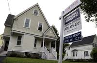 Americans shrugged off rising mortgage rates and bought existing homes in January at the fastest pace since 2007 ...