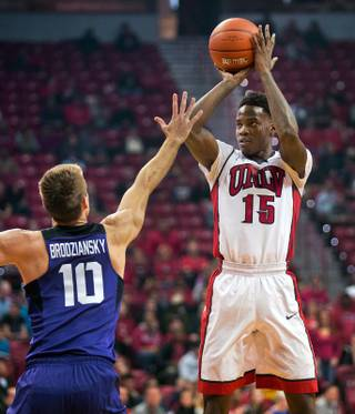 UNLV forward Dwayne Morgan (15) elevates for a jump shot over TCU forward Vladimir Brodziansky (10) during their game at the Thomas & Mack Center on Friday, Nov. 25, 2016.