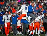 Bishop Gorman QB Tate Martell (18) leaps into the air with head coach Kenny Sanchez as they take the lead during their game at Arbor View on Saturday, Nov. 26, 2016.
