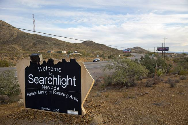 A monument sign welcomes travelers to Searchlight, Nev. Thursday, Dec. 1, 2016.