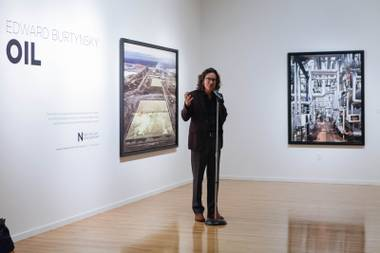 "Nevada Museum of Art's CEO David Walker speaks at the opening reception of ""Edward Burtynsky: Oil"" at the Marjorie Barrick Museum at UNLV on September 23, 2016."