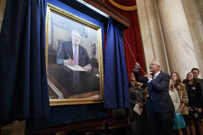 Sen. Harry Reid, D-Nev., unveils his portrait during a ceremony to honor his service in the Senate, on Capitol Hill, Thursday, Dec. 8, 2016, in Washington.