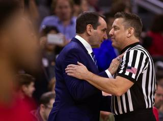 Duke head coach Mike Krzyzewski greets an official as they face UNLV during their game at the T-Mobile Arena on Saturday, Dec. 10, 2016.