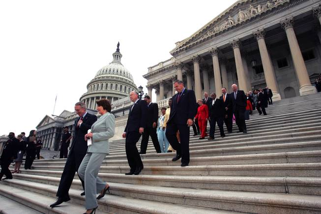 Reid and House Democratic leader Nancy Pelosi with other House and Senate Democratic senators and representatives on the steps of the U.S. Capitol in 2005.