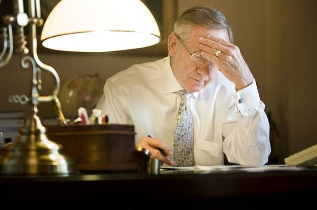 Reid works on a speech in his office on Capitol Hill in 2009.