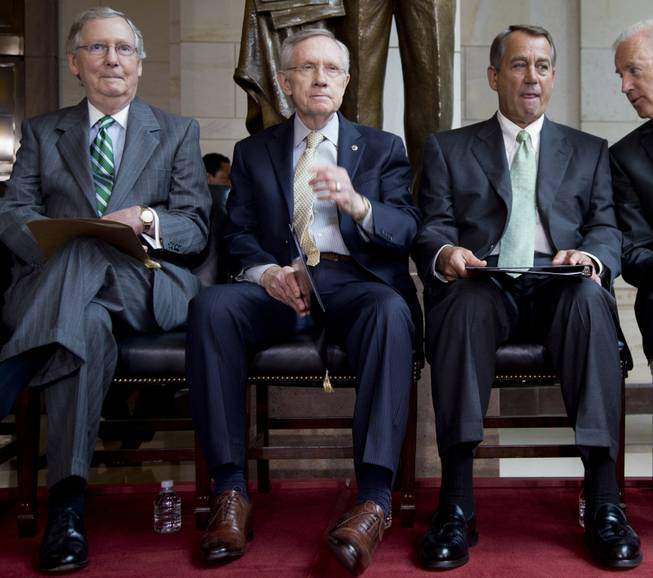 In this 2013 photo, Senate Minority Leader Mitch McConnell, Senate Majority Leader Harry Reid, House Speaker John Boehner and Vice President Joe Biden participate in a ceremony on Capitol Hill.