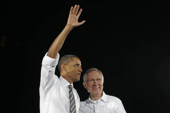 "President Barack Obama and Sen. Harry Reid wave to the crowd after a speech outside Orr Middle School at a ""Moving America Forward"" rally in 2010. Upon Reid's retirement, Obama said: ""It is no exaggeration to say that America wouldn't have accomplished all we have these past eight years — or the past three decades — without Harry Reid. He is as tough and shrewd as they come, unafraid to do the right thing, and has never stopped fighting for folks who can't fight for themselves."""