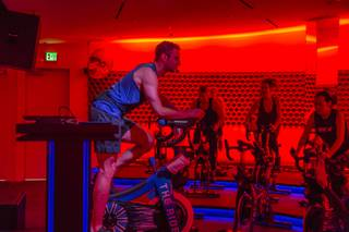 Cycle Instructor Patrick Leahy leads a class at The Ride cycling studio, Thursday, Dec 15, 2016.