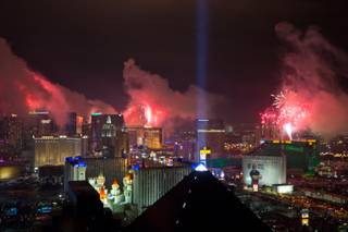 The view from Skyfall Lounge at Delano Las Vegas as fireworks explode above the Las Vegas Strip just after midnight on New Year's Eve, Sunday, Jan. 1, 2017.