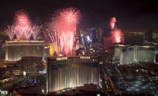 At the stroke of midnight on New Years Eve,  fireworks erupt over the Las Vegas Strip in this view looking south from the rooftop of the Trump International Hotel in Las Vegas on Sunday, Jan.1, 2017.  CREDIT: Mark Damon/Las Vegas News Bureau