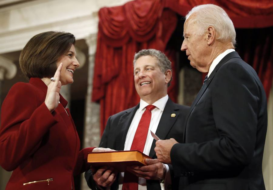 Vice President Joe Biden shakes hands with Sen. Catherine Cortez Masto, D-Nev., as her husband, Paul Masto, holds the Bible during a mock swearing-in ceremony in the Old Senate Chamber on Capitol Hill in Washington, D.C. on Tuesday, Jan. 3, 2017.