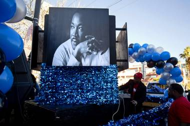 People put finishing touches on the Voices float before the start of the 35th annual Dr. Martin Luther King Jr. Day Parade in downtown Las Vegas Monday, Jan. 16, 2017. MGM Resorts International was the presenting sponsor.