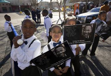 Boys in Bowties from Wendell Williams Elementary School wait for the start of the 35th annual Dr. Martin Luther King Jr. Day Parade in downtown Las Vegas Monday, Jan. 16, 2017. MGM Resorts International was the presenting sponsor.