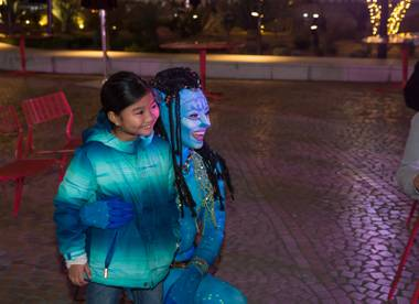 "Cast members from Cirque Du Soliel's TORUK- The First Flight interact with tourists during ""Party at the Park"" in front of the T-Mobile Arena, Tuesday Jan 17, 2017."