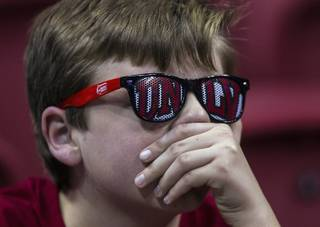 A young UNLV fan shows his concern as Air Force takes the lead during their game at the Thomas & Mack Center on Saturday, Jan. 21, 2017.