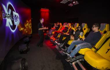 Chad Hiratani with Dark Ride XD prepares players for their ride at Gameworks at Town Square where they are unveiling the new 7-D cinema experience on Thursday, Jan. 26, 2017.