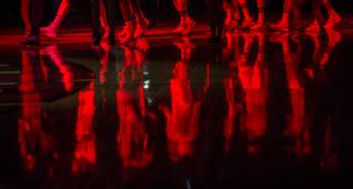 UNLV players are reflected on the court as the opening fireworks conclude before their game at the Thomas & Mack Center on Wednesday, Feb. 1, 2017.
