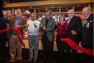 Legendary broadcaster Brent Musburger cuts a ribbon joined by other invited guests as South Point Hotel and VSiN (Vegas Stats and Information Network) host a special ribbon cutting ceremony revealing the custom-built sports broadcasting studio and new home to on Friday, Feb. 3, 2017.